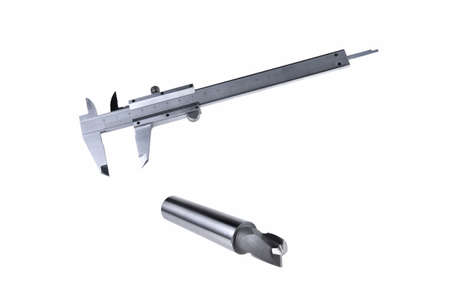 cutters for metal processing, fixtures and tools for processing measurements of manufactured elements on a white background close-up