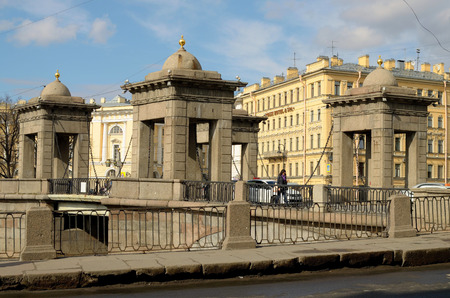 obelisk stone: Lomonosov bridge with towers, pavilions is in the city of St. Petersburg on the river Fontanka. Stock Photo
