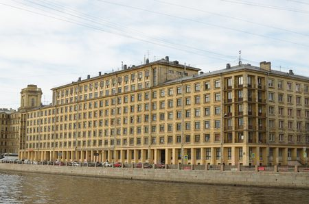 hostel: A large building stands on the embankment of the river in the city .This is the hostel for the students of one of institutov. Stock Photo