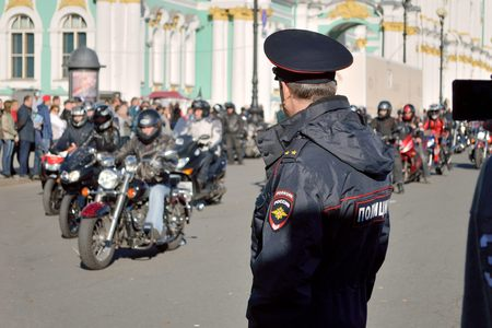 travelled: Russia.Saint-Petersburg.20 July,2015.At the Palace square near the Winter Palace hosted the festival of bikers.They then travelled along the route.Police are on guard.