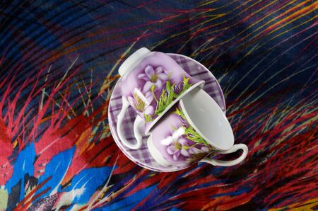 lurex: Two coffee cups with saucers made of earthenware with shiny cloth. Stock Photo