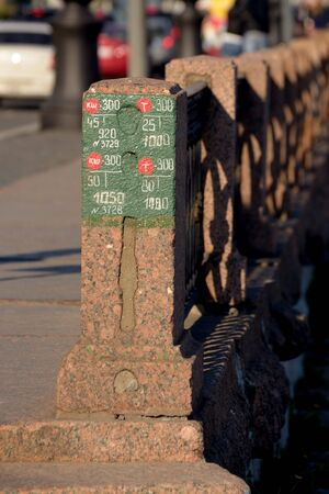 electric circuit: city.Granite fence on the University embankment in St. Petersburg.The post drawn electric circuit