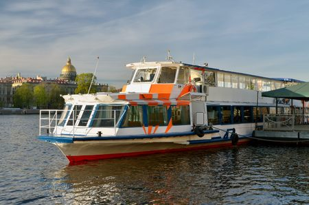 begun: In St.-Petersburg has begun the tourist season.Boats and ships with tourists go along the rivers and canals of the city. Stock Photo
