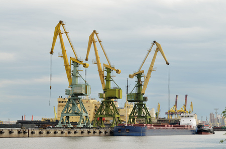 clock work: Russia.Saint-Petersburg.The seaport is working on loading ships.The round the clock work.