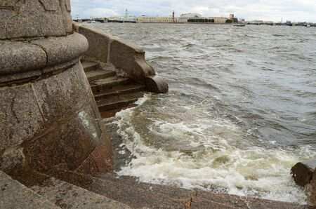 strongly: Russia Saint Petersburg.The citys storm warning.The water level in Neva has risen strongly. Stock Photo