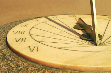 Old historic design.a sundial tells the time by shadows from the sun. Stock Photo