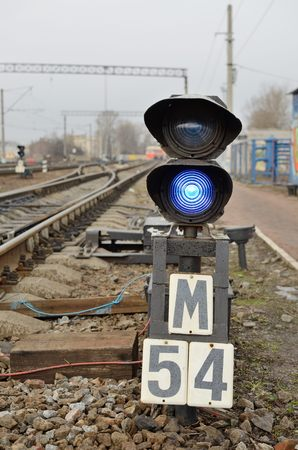 regulate: Traffic lights on the railway, regulate the movement of trains.They show the driver when to go. Stock Photo