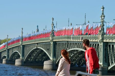 fascism: The big bridge in the town decorated with flags in memory of the victory over fascism. Stock Photo
