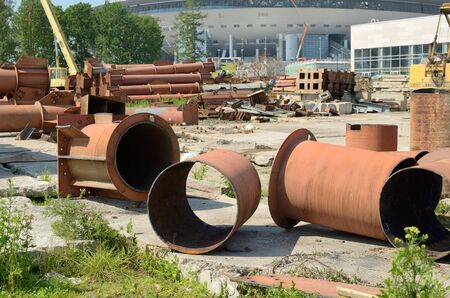 scrap iron: Scrap metal lies at the construction.There is an iron pipe,cut with a blowtorch.
