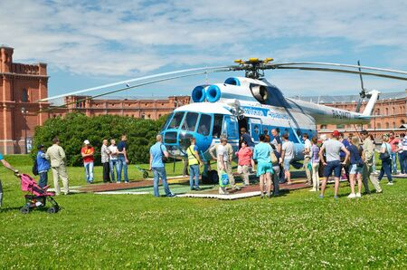 airstrip: 17.07.2016.Russia.Saint-Petersburg.Passengers boarding a helicopter for a tour of the sky.