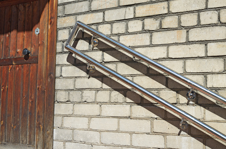 metal handrail: On the wall fixed handrails that provide safety when descending the stairs.