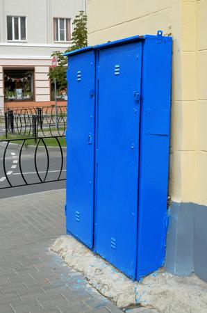 street corner: Iron box standing on a street corner. Stock Photo