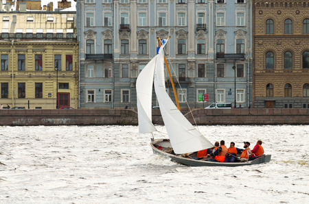 wind down: 13.08.2016.Russia.Saint-Petersburg.The boat floats down the river under sail,catching the wind.