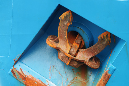 ship anchor: A heavy anchor holds a ship in one place.