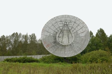 radio telescope: Old radio telescope - the tool for studying the galaxy . Stock Photo