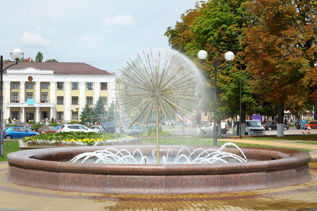 coolness: The beautiful circular fountain in the town square. Stock Photo