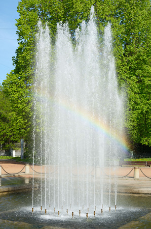 appeared: On a Sunny day at the fountain, a rainbow appeared.
