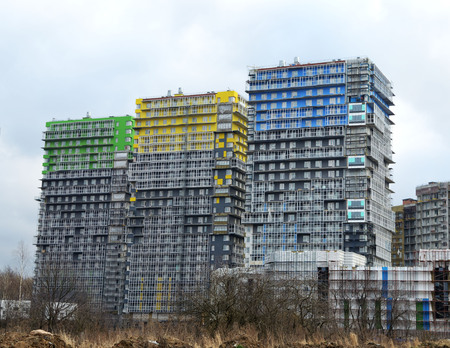 boundaries: Construction of new homes expands the boundaries of the city. Stock Photo