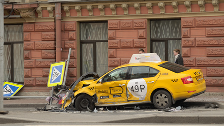 violation: 16.10.2016.Russia.Saint-Petersburg.The taxi driver did not cope with driving and crashed into a pedestrian sign. Editorial
