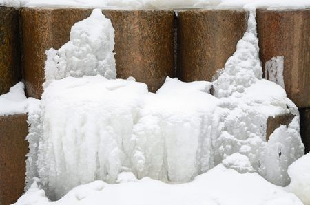 froze: The water in the river under the bridge froze in the winter. Stock Photo