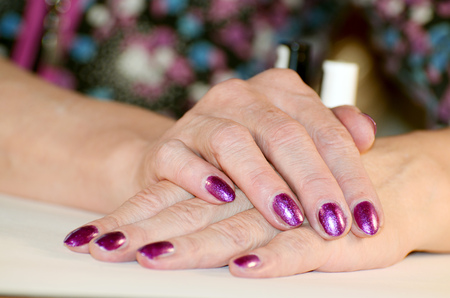The manicure making female hands well groomed,clean and attractive.