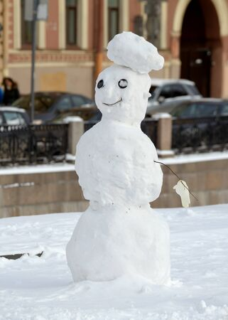 Children did in the winter in the street of a snowman. Stock Photo