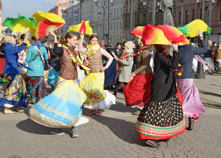 12.03.2017.Russia.Saint-Petersburg.On the street gathered followers of Lord Krishna.Young people are dancing,collecting alms and distributing sweets.