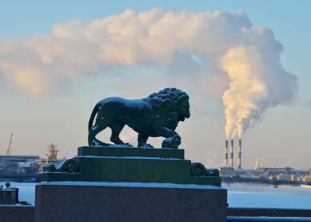 City skyline in winter.Smoke from factory pipe.