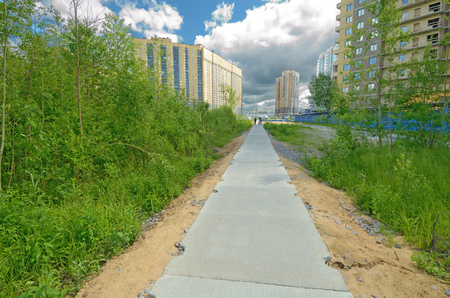 A concrete path for pedestrians that leads to the Park .