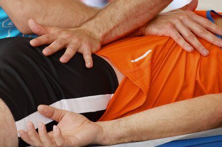 Sports massage therapists help athletes after a marathon race.