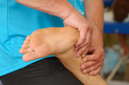 Sports massage therapists help athletes after a marathon race.