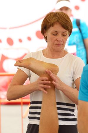 09.07.2017.Russia.Saint-Petersburg.Sports massage therapists help athletes after a marathon race. Editorial