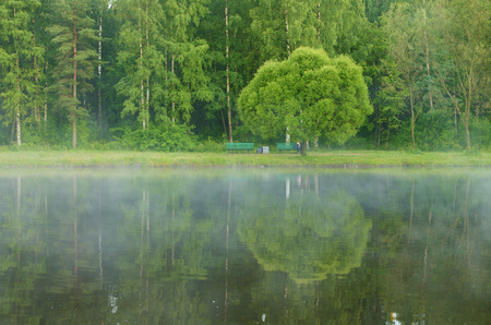 After night fell, began to evaporate the water in the lake. Stock Photo