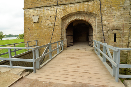 lift gate: Stone gate to the fortress.Before them the bridge that rises. Editorial