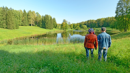 Beautiful scenery in the Park.A man with a woman admiring the nature.