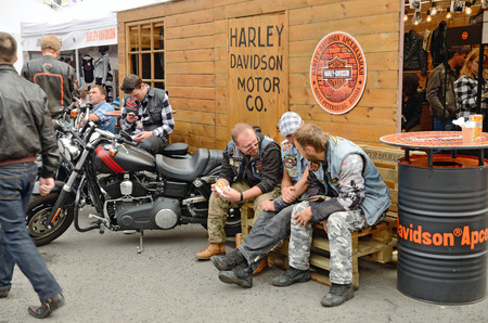 13.08.2016.Russia.Saint-Petersburg.At the festival of bikers Harley Davis.Men discuss the latest news.