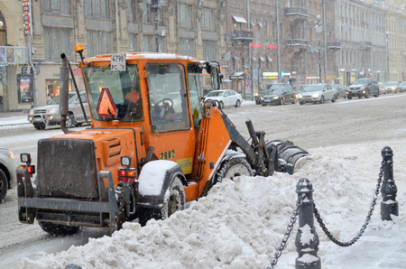 Saint-Petersburg.Russia.12.21.2017.Heavy snowfall in the city.Street cleaning is carried out by special vehicles. Editorial