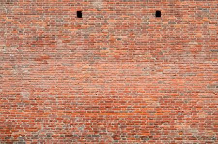 Wall of red brick.Masonry has a peculiar texture.