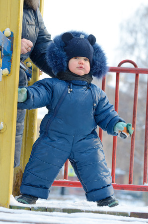 Little Timosha is playing on the Playground.Very cheerful and playful child. Stock Photo