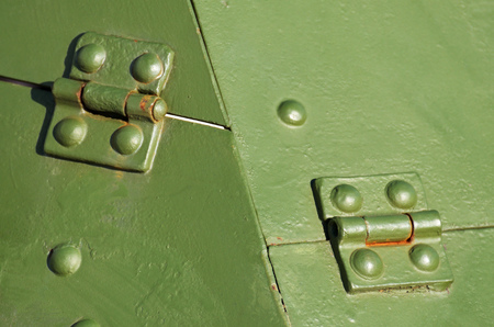 Armor plates on the first armored personnel carriers.The connection of the parts with rivets. Stock Photo
