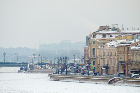 Views of the city in winter.City street along the river embankment . Stock Photo