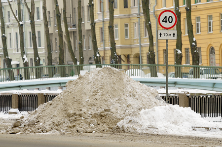 A lot of snow fell.Utilities clean it from the road. Stock Photo