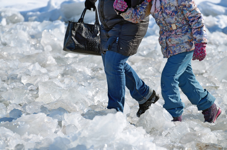 Difficult passage over the ice.Walking on broken ice is difficult and dangerous. Stock Photo