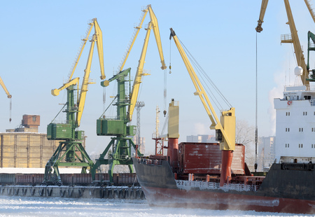 Active work in the port.In the holds of the ship is loading. Stock Photo