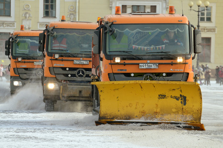 Saint-Petersburg.Russia.March.18.2018.Night in the city the snow fell.His cleaning went snow-removal vehicles.They cleared the roads on the streets of the city.