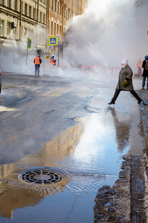 Saint-Petersburg.Russia.March.28.2018.There was a breakthrough of a heating main with hot water.The incident occurred on Stolyarnyy pereulok near Sennaya square.