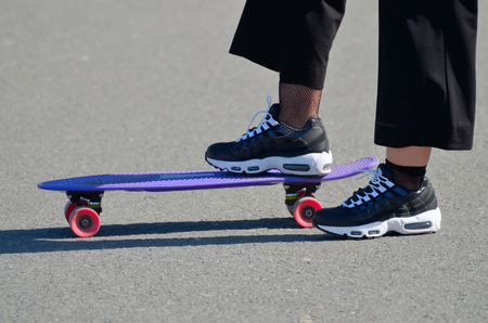 Skateboarding on the asphalt track.Favorite entertainment for young people.