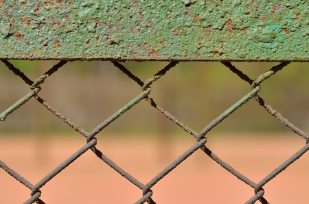 A fence made of iron net. The wire is twisted into a rigid mesh. Stock Photo