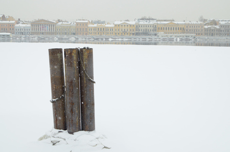 Iron poles in the Harbor Bay. They are attached moored ships.