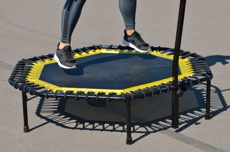 Jumping on an elastic trampoline.This exercise develops coordination.Legs get stronger. 写真素材 - 103551025